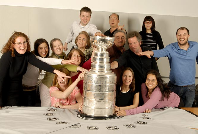 Sports Illustrated's photo department, lead by director of photography Steve Fine (black shirt), mob the cup during its office visit.
