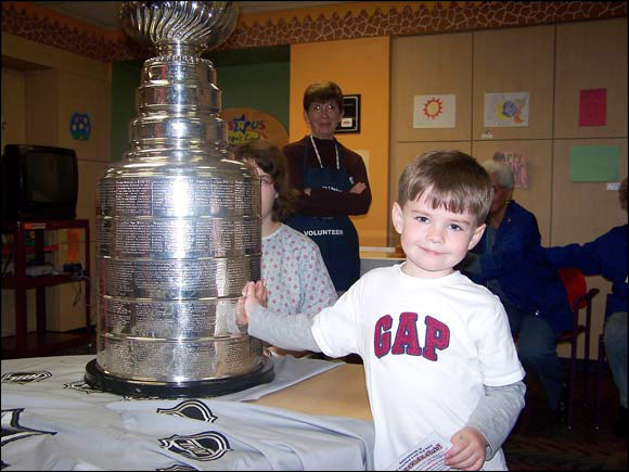 My 5-year-old Sabres fan/son with the cup in Buffalo. -- James Rooney