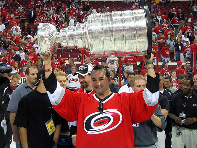 """""""Somehow we weasled our way onto the ice after the Hurricanes won the cup.  They thought that we were family members of one of the players. What a picture with the cup.  The arena is still rather packed too.  I have this framed proudly."""" -- Barry Crell"""