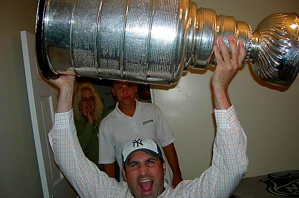 """""""During the homecoming of John Alloway, Assistant Equipment Manager of the Anaheim Ducks, family and friends were able to share a great photo-op. He's an ultimate class act and we had a great time.  I obviously had a better time than others"""" -- Chris Piccone proudly hoisting the Cup."""
