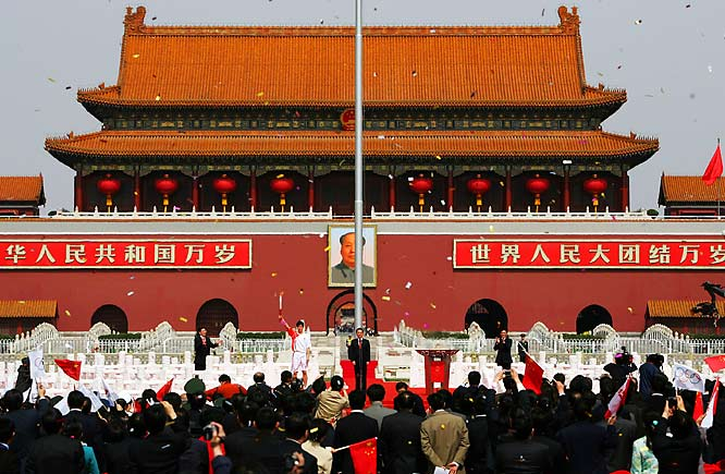 Things were more secure in Tiananmen Square, where gold-medalist hurdler and Chinese favorite at this year's Games, Liu Xiang, held the flame high, officially kicking off the 2008 torch relay.