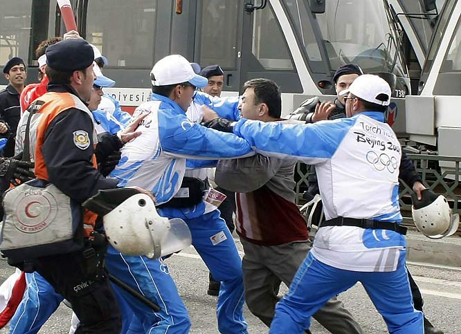 In the city's most touristic areas, nearly 200 Muslims staged protests as the torch traveled through Istanbul, Turkey. Police managed to keep the flame safe, though, fending off demonstrators along its path.