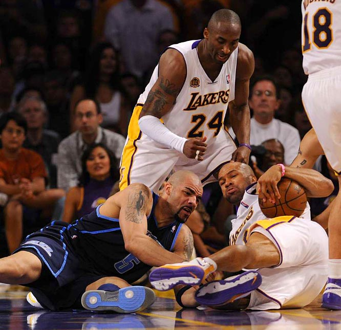 Derek Fisher (right) and Carlos Boozer battle for the ball as Kobe Bryant looks on during the Lakers 109-98 victory in Game 1 on Sunday. Fisher had a career playoff-high six steals.