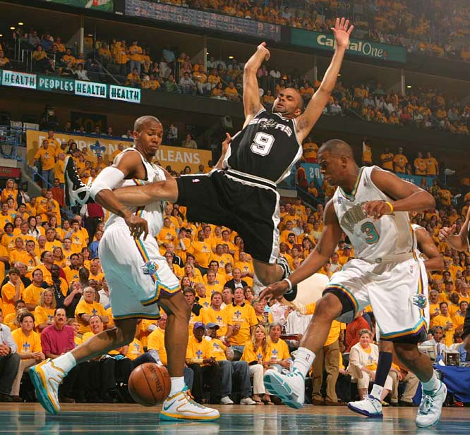 Tony Parker looks for a foul while being defended by David West (left) and Chris Paul during Game 1 in New Orleans on Saturday.