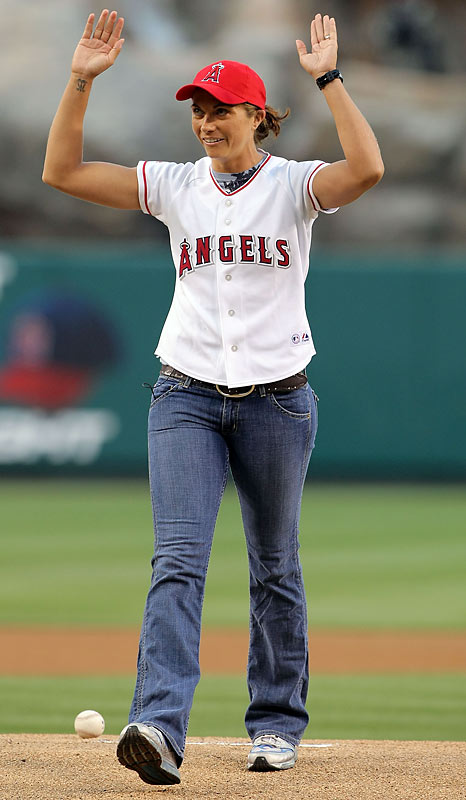 Professional beach volleyball player -- and owner of one of the best names in sports -- Misty May-Treanor waves to the crowd before throwing out the first pitch at Wednesday's Angels-A's game.