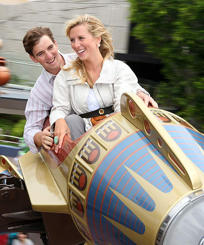 Super Bowl MVP Eli Manning and new wife, Abby McGrew, finally got that trip to Disneyland.