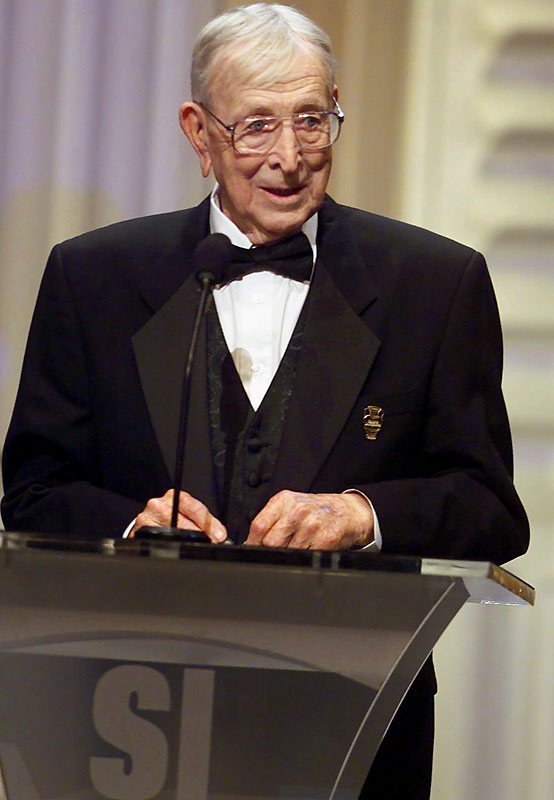"""In 2000, Wooden accepted the lifetime achievement """"Legacy Award"""" from Sports Illustrated."""