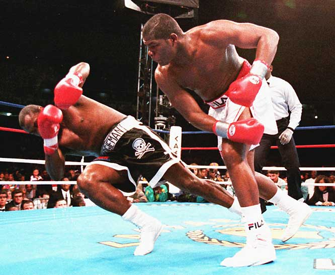 Riddick Bowe TKOs Jesse Ferguson in just two rounds to retain the WBA heavyweight title and improve his record to 34-0.