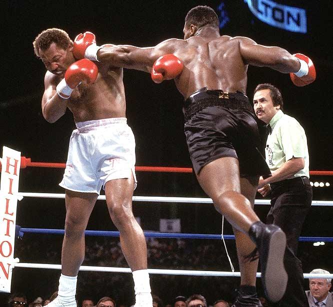 Mike Tyson TKOs Pinklon Thomas in six rounds to retain the WBA and WBC Heavyweight titles.