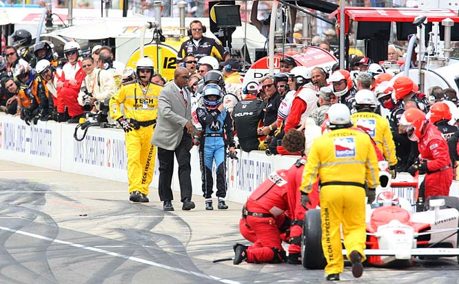 An angry Danica Patrick walks down pit road to have a few words with Ryan Briscoe after he knocked her out of the race. Indy 500 security officials intervened before she reached him.