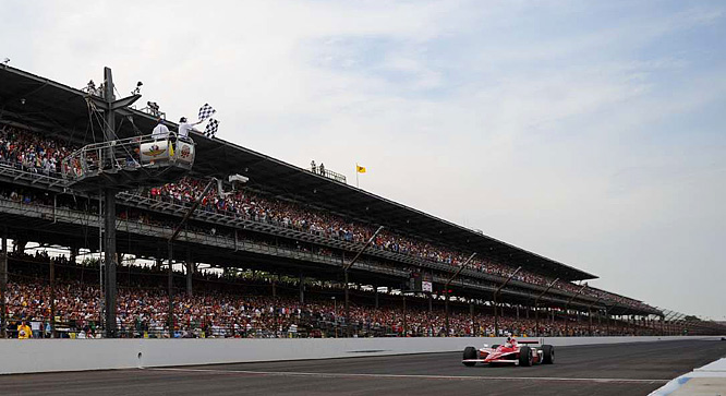 Scott Dixon takes the checkered flag to win the 92nd Indianapolis 500.