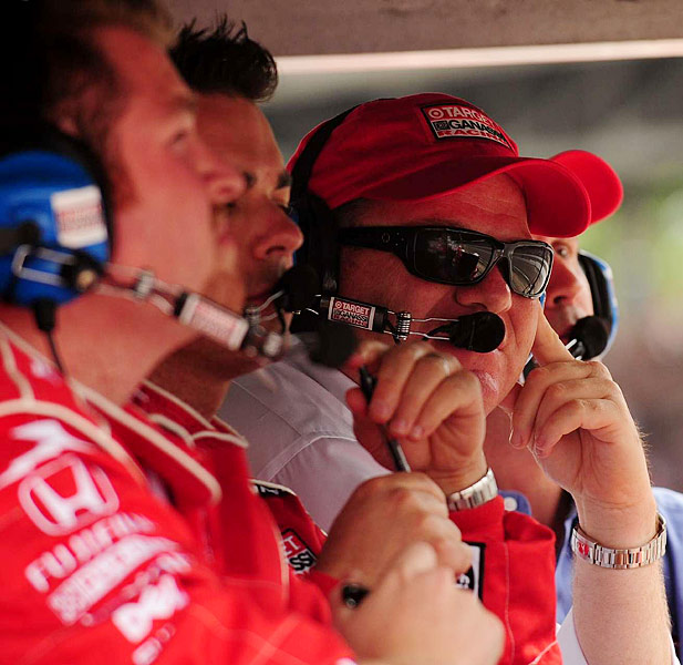 Car owner Chip Ganassi (with hat) keeps a eye on his drivers, Scott Dixon and Dan Wheldon.