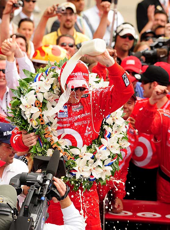 Scott Dixon douses himself with milk after his historic win.