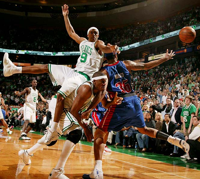 Rajon Rondo (9) goes over teammate James Posey (41) as they fought for the ball with Rasheed Wallace during Game 2. Detroit won 103-97 to tie the series.