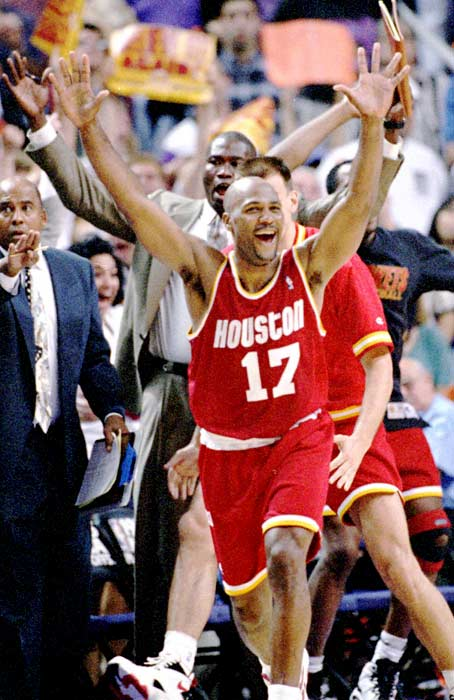 Guard Mario Elie nailed a go-ahead three-pointer from the corner with 7.1 seconds left as the Rockets won 115-114 at Phoenix, completing their comeback from a 3-1 series deficit en route to claiming a second straight NBA title. Kevin Johnson scored 46 points for the Suns.