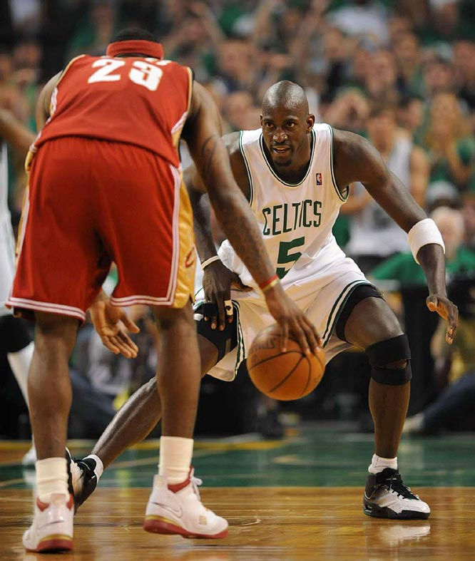 Garnett attempting to maintain a defensive position against James.
