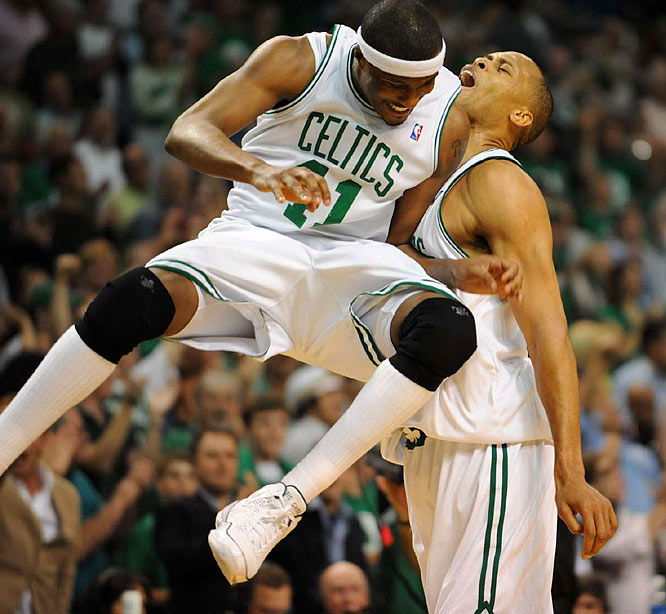 Reserves James Posey and P.J., Brown of the Celtics celebrating two of Brown's 10 points against the Cavaliers.