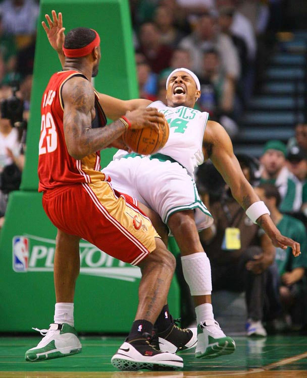 Celtics forward Paul Pierce tries to draw a charge on Cavs forward LeBron James during Game 1 of their second-round series. Boston currently leads the series two games to one.