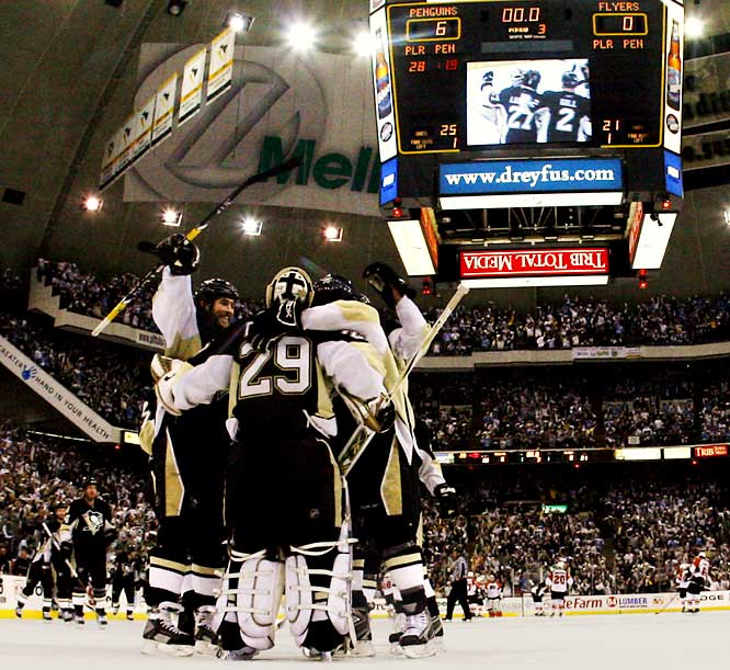 A survivor of the Pens' lean 58-point 2003-04 season, winger Ryan Malone (far left) opened the spigot on a laugher with a power play score at 2:30 of the first period. He dished a brilliant, hard-fought assist on Evgeni Malkin's goal that made it 2-0 a little more than seven minutes later. Malone's second tally, midway through the second period, put the Pens up 4-0. Meanwhile, Marian Hossa continued to shine with three assists and a goal. Goalie Marc-Andre Fleury (29) made 21 saves for his third shutout of the playoffs as the Penguins advanced to the Stanley Cup Final for the first time since 1992.