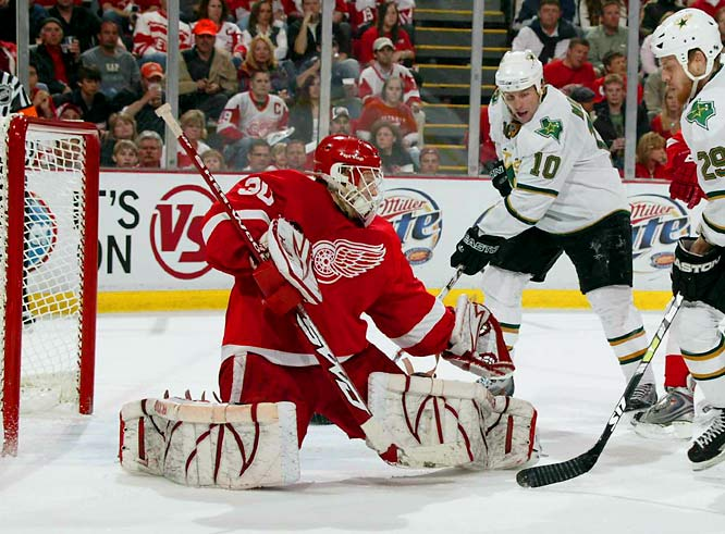 With Johan Franzen sidelined by concussion-like symptoms, Henrik Zetterberg and Valterri Filppula stepped up. Filppula won 10 of 16 face-offs and Zetterberg's blistering one-timer on a first-period power play proved to be the game-winner. Chris Osgood (left) sparkled in Detroit's net, stopping 17 of 18 shots to preserve the win.