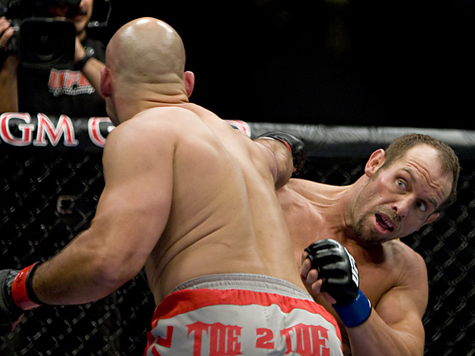 Carwin (near left) dropped Wellisch to the canvas and finished him off with strikes for a TKO in the first round.