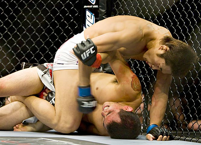 Using his ground-and-pound game to its fullest, Kim (top) threw Tan a slew of elbows, punches and forearm strikes before earning the TKO in the third round.