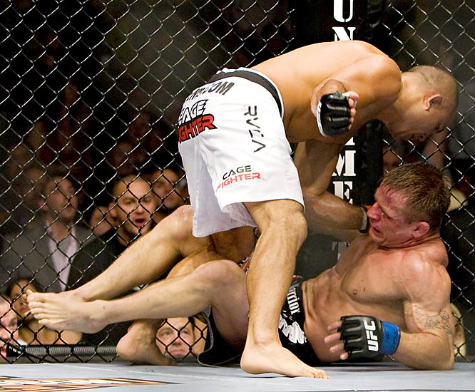 Penn (white trunks) sent Sherk a flying knee before blasting him with strikes on the ground. ''The Prodigy'' successfully defended his lightweight title with a third-round TKO.