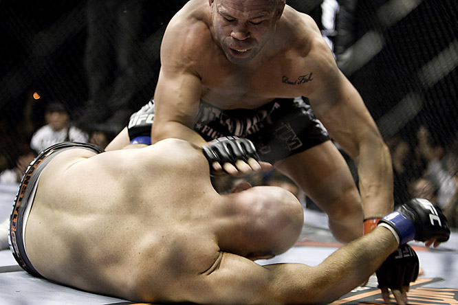 With pressure riding on this bout for Silva, ''The Axe Murderer'' hardly wilted. Throwing Jardine (bottom) multiple strikes on the ground, Silva earned a KO in the first round.