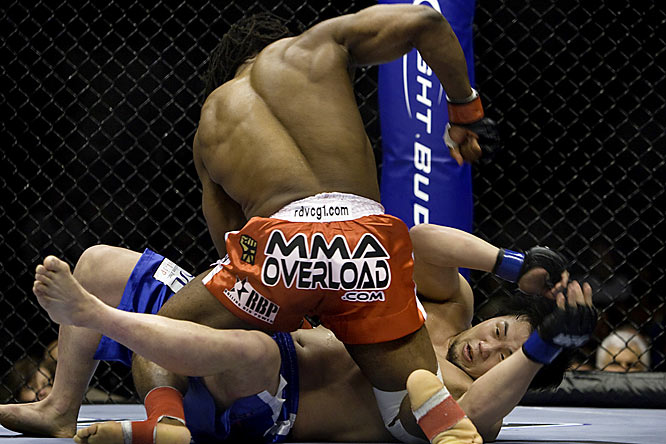 After a number of knees and kicks, Sokoudjou (red trunks) finished off his opponent for a TKO in the first round.