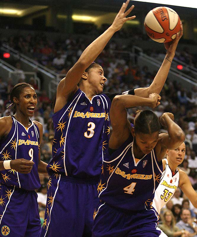 "In her first game as an L.A. Spark, Candace Parker scored a league-debut record 34 points and grabbed 12 rebounds. ""It was better than I expected,"" said the former Tennessee star."