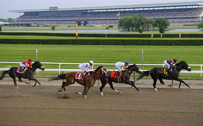 A heavy favorite to win the Triple Crown, Big Brown (1) runs third in the backstretch behind winner Da' Tara and Tale of Ekati (7).