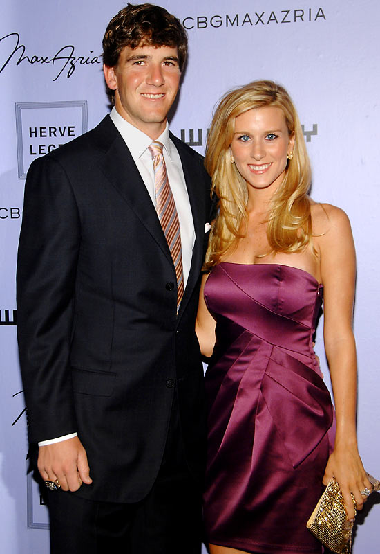 Eli Manning and wife Abby McGrew, shown here at an event on Tuesday, still look like a happily married couple.