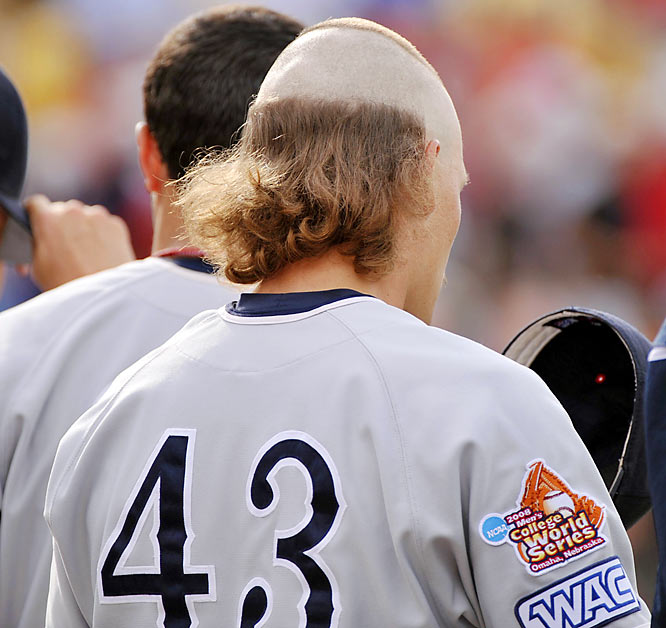 Fresno State's Kris Tomlinson, shown here before Game 1 of the College World Series championship series, had to have lost a bet.