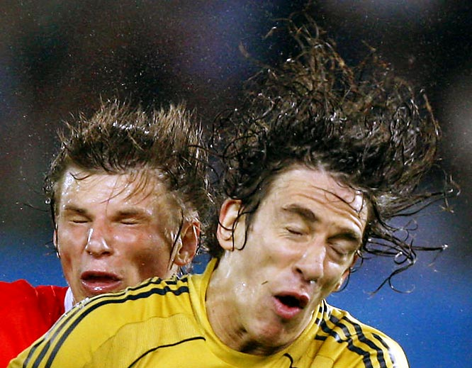 We're not sure what's going on in this photo of Spain's Carles Puyol (right) and Russia's Andrei Arshavin from Thursday's Euro Cup game, but it looks intense.