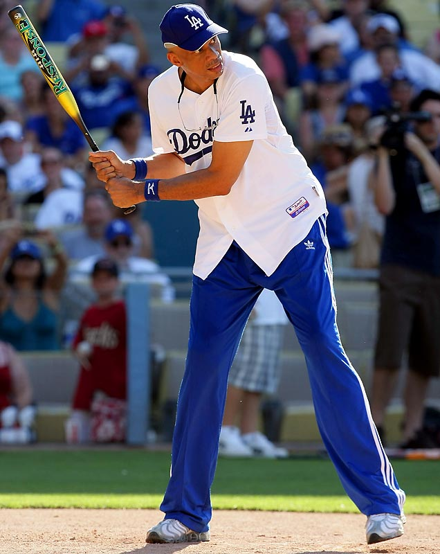 Kareem Abdul-Jabbar, shown here at last Saturday's Annual Hollywood Stars Game at Dodger Stadium, looks a little stiff at the plate.