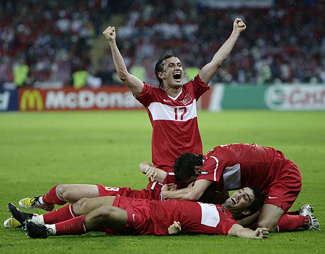 In a winner-take-all match for a spot in the knockout stage, the Czechs opened a 2-0 lead on Jaroslav Plasil's second-half strike. When the Turks equalized on a pair of late goals, the teams appeared headed for penalty kicks. But Nihat (bottom) left nothing to chance, delivering a stunning winner in the 89th minute. The Villarreal forward's blast from the edge of the area bent past goalkeeper Petr Cech, struck the underside of the crossbar and caromed in, sealing Turkey's miraculous 3-2 victory.