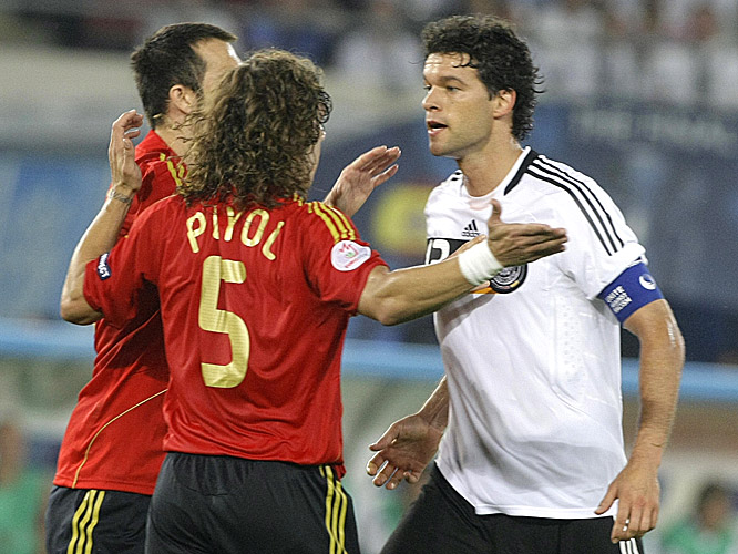 Michael Ballack argues with Spain's Carlos Puyol in the second half.