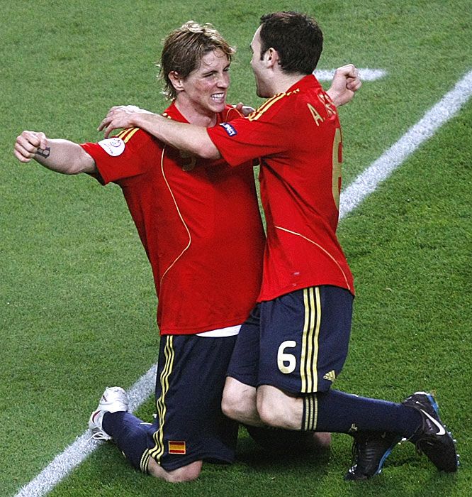 Fernando Torres is greeted by teammate Andres Iniesta just after scoring Spain's deciding goal.