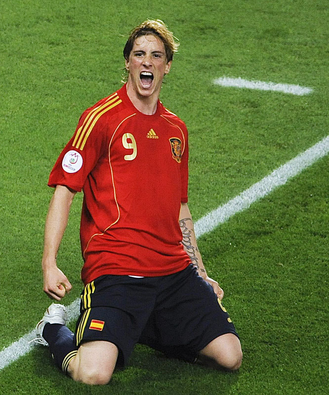 Fernando Torres celebrates after scoring the game-winning goal for Spain.