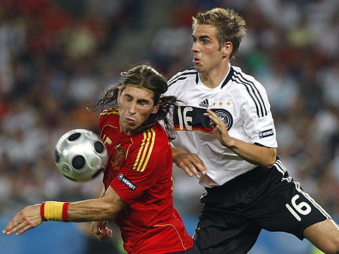 Spain's Sergio Ramos and Germany's Philip Lahm fight for a ball.
