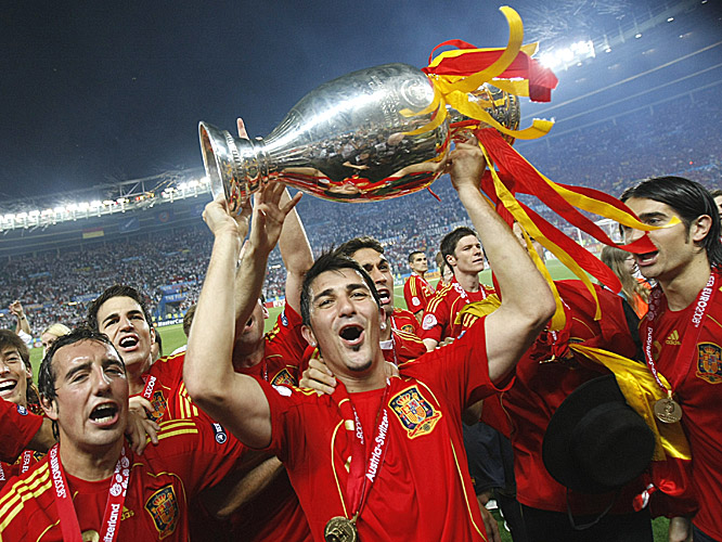 David Villa, who missed the final but still ended as the tournament's top goal scorer, shows off the championship trophy.
