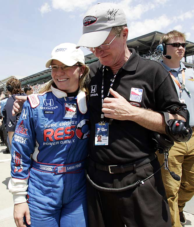 After qualifying for the 92nd Indianapolis 500, driver Sarah Fisher gets a congratulations hug from father,  James.