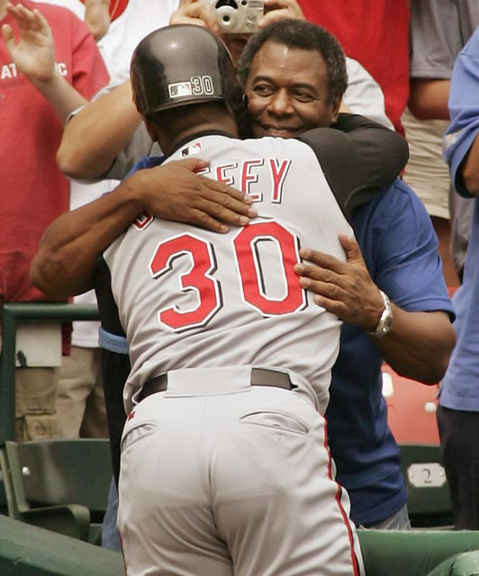 On Father's Day with his dad present, Ken Griffey, Jr. nails a 6th inning fastball for his 500th career home run. The Reds' center fielder becomes the 20th major leaguer and the sixth youngest (34) to reach the milestone.
