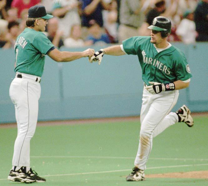 In a 8-7 victory over the A's, Jay Buhner becomes the first Mariner to hit for the cycle when he triples and scores the winning run in the 14th inning.