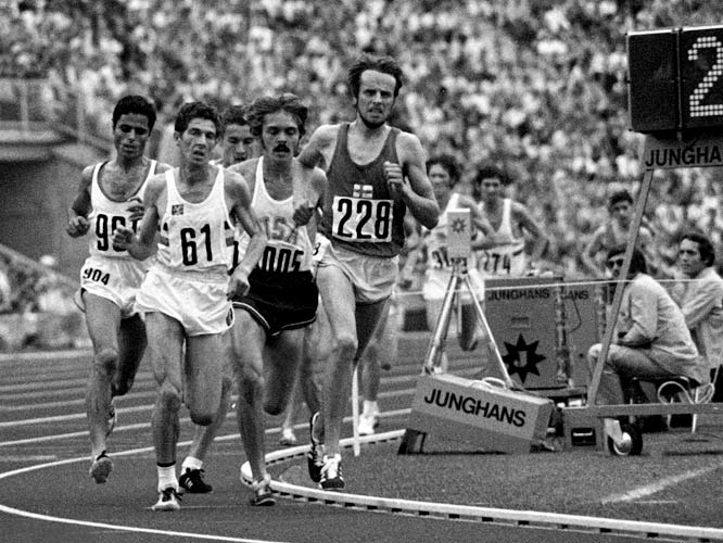 The cop from Finland was running in fifth place when he tripped and fell to the track with 14 laps to go. Passed (and partially trampled) by the rest of the leading pack, Virén got back on his feet, caught up and eventually fought all the way to the front, setting a world record in the process. (Photo from the 5,000m race)