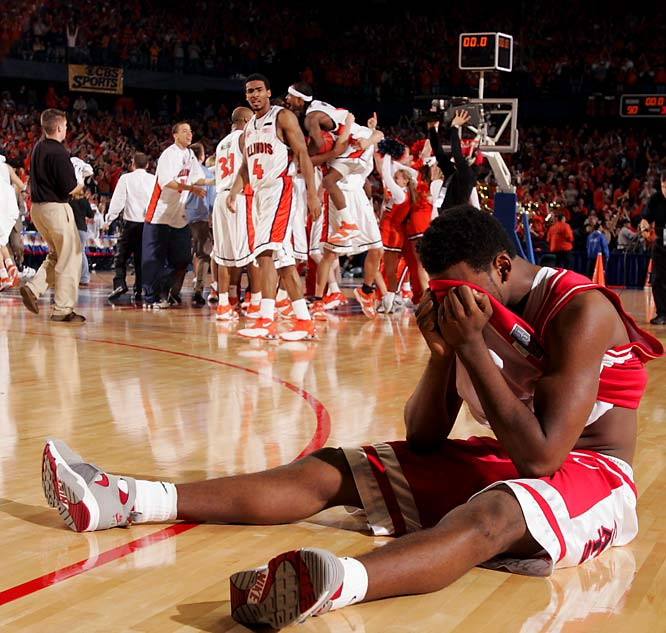 Jawann McClellan sat dejected after the Illini, trailing by 15 with just four minutes to play, went on a 20-5 run behind Luther Head and Deron Williams to top Arizona by one in overtime.