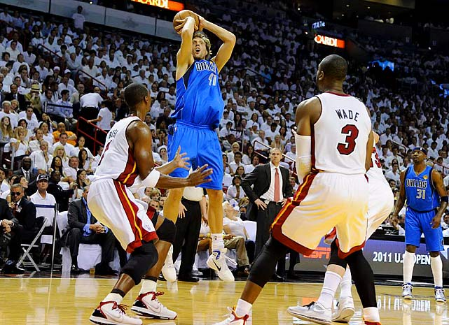 Dirk Nowitzki shook off an injury to his non-shooting hand and made the tie-breaking layup with 3.6 seconds left in regulation, and the Mavs roared back from a 15-point deficit in the fourth quarter to stun the Heat 95-93 and tie the series at one game apiece.