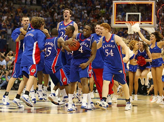It really isn't over 'tll it's over. With 2.1 seconds remaining in regulation of the championship game, Kansas guard Mario Chalmers nailed a three pointer to force overtime against Memphis. The Jayhawks then outscored the Tigers 12-5 to win their third NCAA title.