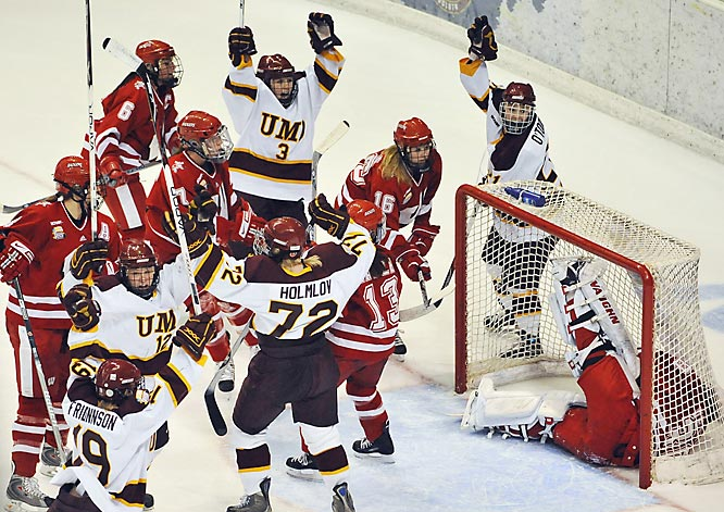 One year after falling to Wisconsin 4-1 in the 2007 championship game, Minnesota-Duluth won it's first title in eight years and first since 2003. Goalie Kim Martin stopped 28 shots to lead the Bulldogs past Wisconsin 4-0.