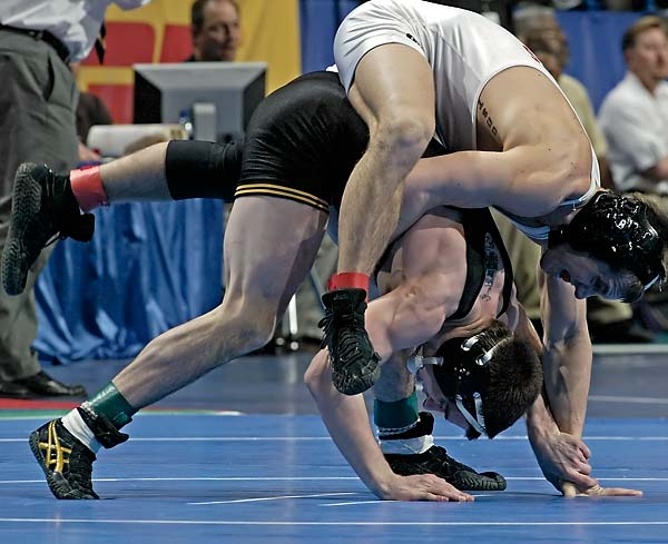 Led by Brent Metcalf (bottom) top-ranked Iowa clinched its 21st national title and its first since 2000. During the championships the Hawkeyes crowned seven All-Americas.